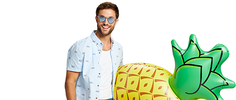 Man holding an inflatable pineapple pool float.